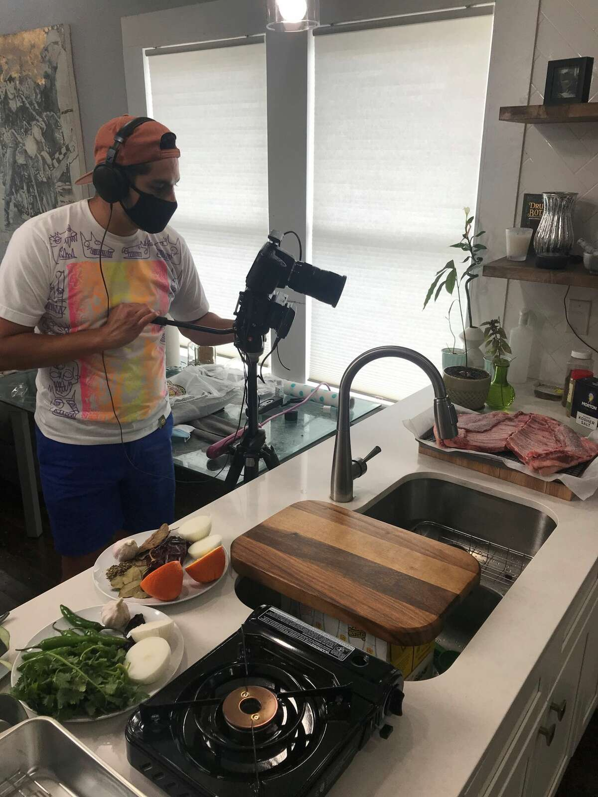 San Antonio resident Diego Ponce is shown filming an episode of a cooking show for the YouTube channel,