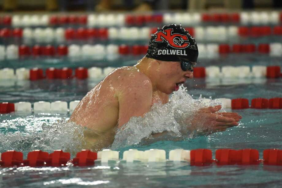 New Canaan's Patrick Colwell swims to a gold medal in the 200-yard individual medley at the FCIAC swim finals at Greenwich High School on Thursday, Feb. 28. Photo: Dave Stewart / Hearst Connecticut Media / Hearst Connecticut Media