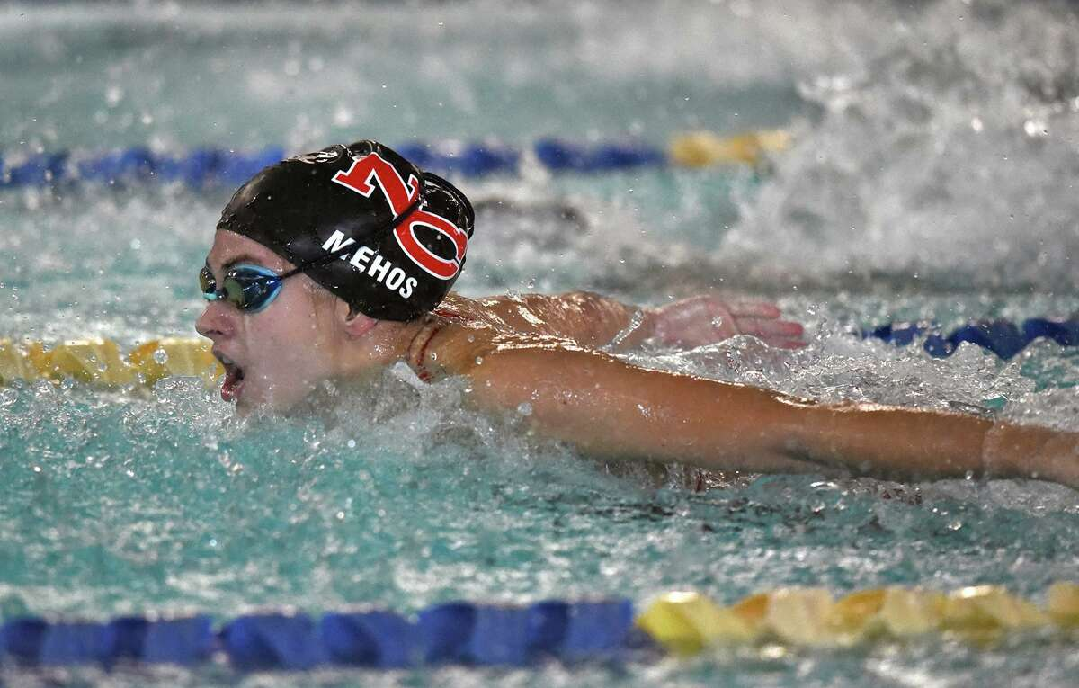 New Canaan's Alexandra Mehos competes in the 100 butterfly during a swim meet at the New Canaan YMCA on Oct. 10, 2018.