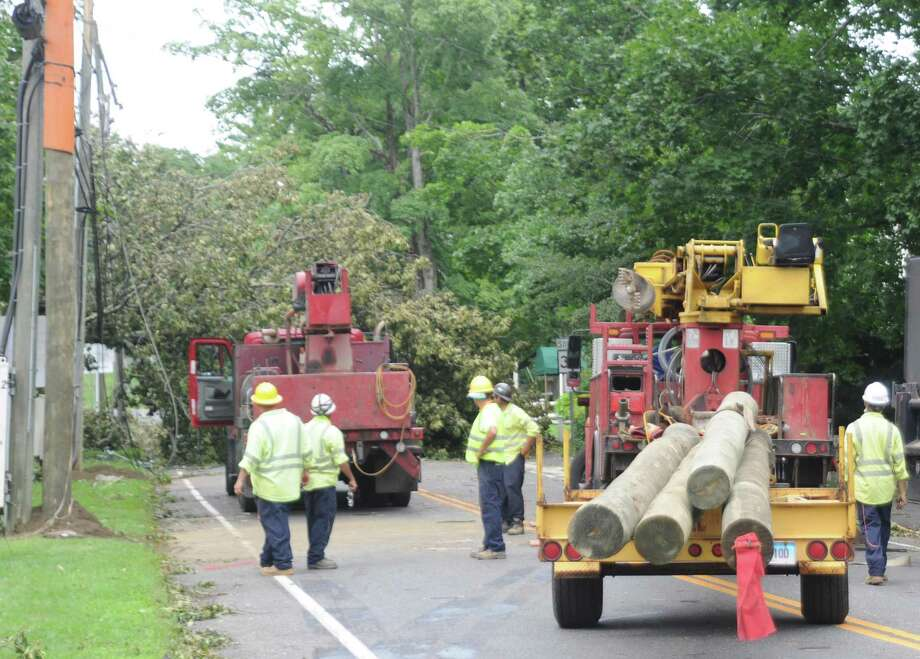 Utility crews in Ridgefield work to get electricity back following Tropical Storm Isaias which hit the state, causing massive power outages, on Aug. 4. Photo: Macklin Reid / Hearst Connecticut Meda
