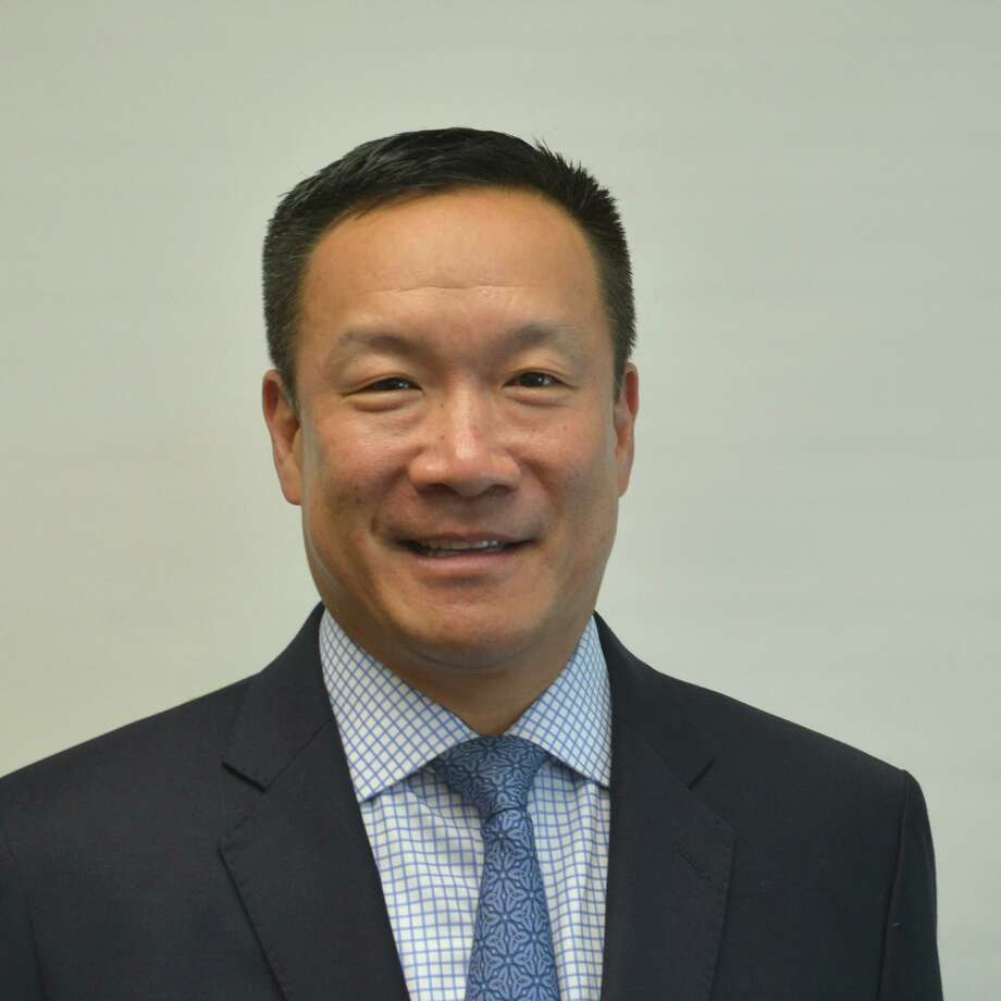 Andrew Leung was recently hired as vice president at wealth management firm Procyon Partners. Photo: Contributed Photo / Connecticut Post