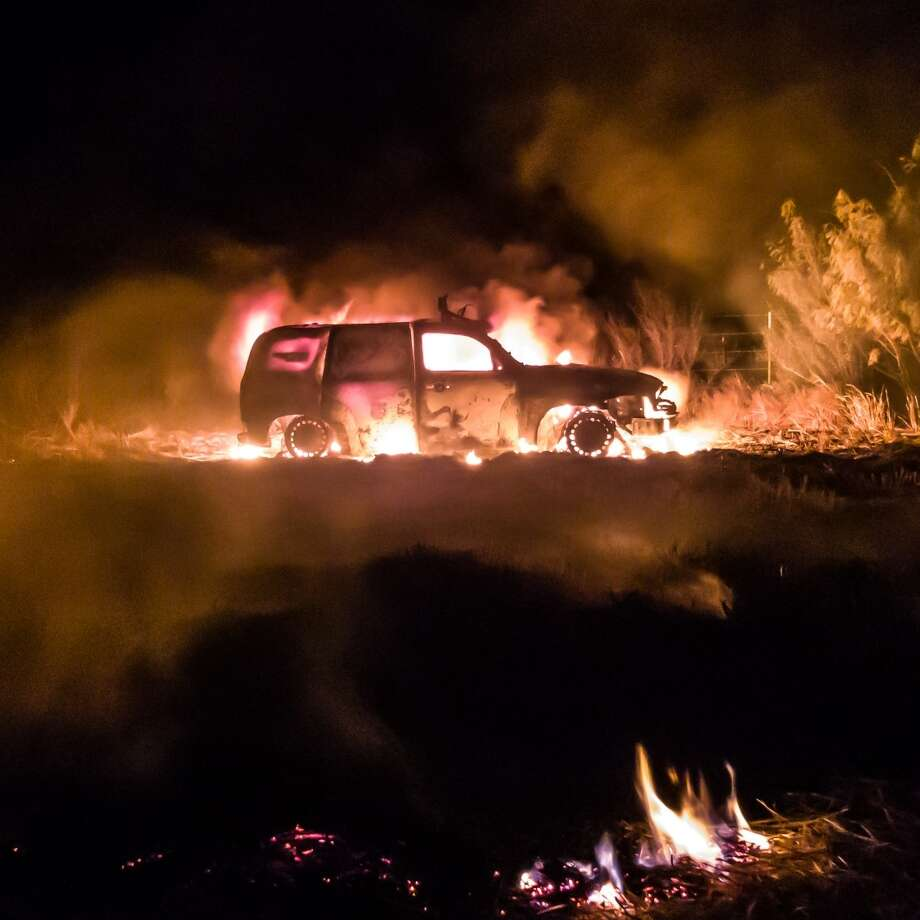 U.S. Border Patrol agents said they stopped a human smuggling attempt and rescued people from this vehicle on fire. Photo: Courtesy Photo
