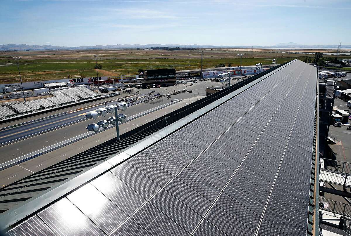 Solar panels on the roof of the main grandstand collect energy from the sun at Sonoma Raceway in Sonoma, Calif. on Thursday, July 18, 2019. The race track, which is celebrating its 50th anniversary this season, is taking strides in reducing its carbon footprint.