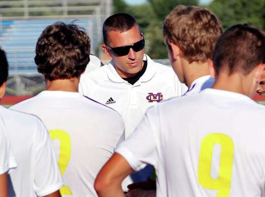 CM head coach Derek Jarman talks to his team last season. With the IHSA moving boys soccer from fall to spring, Jarman and other coaches in Illinois are faced with how to prepare using the fall for using contact hours for training. Photo: Pete Hayes | The Telegraph