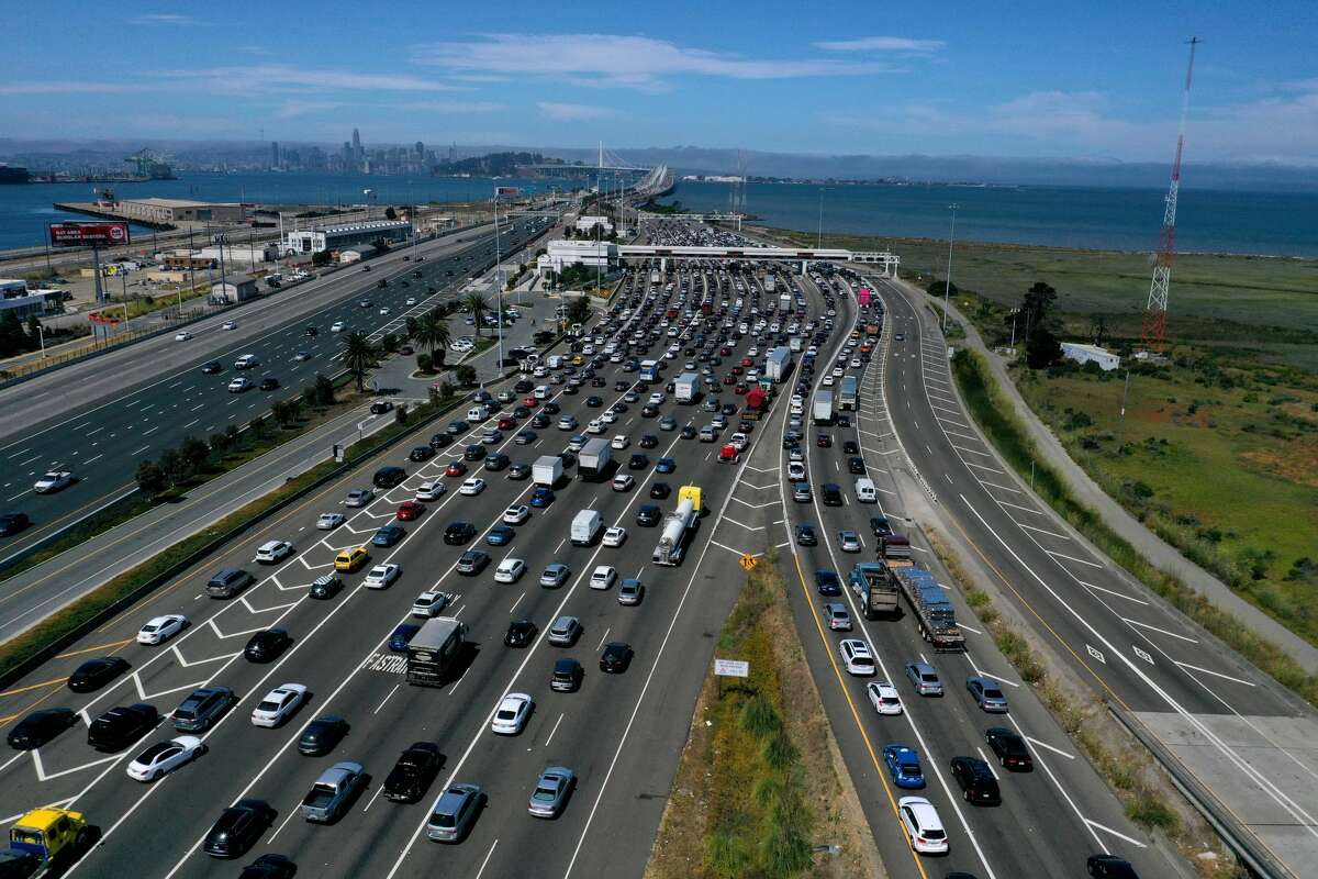 FILE - Traffic backs up at the San Francisco-Oakland Bay Bridge toll plaza along Interstate 80 on July 25, 2019 in Oakland, California.