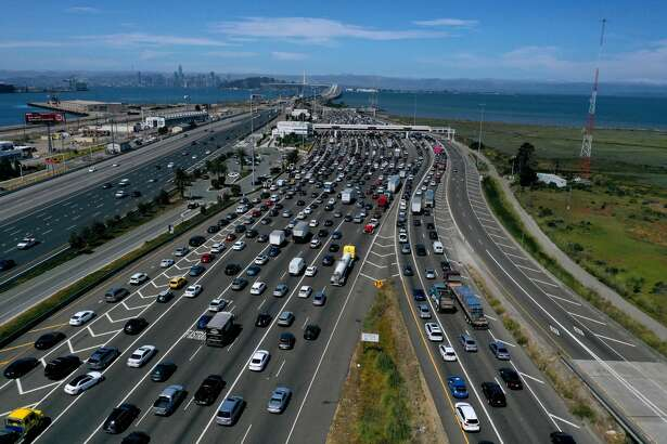 SAN RAFAEL, CALIFORNIA - JULY 25: Traffic backs up at the San Francisco-Oakland Bay Bridge toll plaza along Interstate 80 on July 25, 2019 in Oakland, California. The State of California and four of the largest automakers in the world - Ford, VW, Honda and BMW - have struck a deal to reduce auto emissions in the State of California ahead of the Trump administration's plans to eliminate an Obama-era regulation to reduce emissions from cars that are believed to contribute to global warming. (Photo by Justin Sullivan/Getty Images)