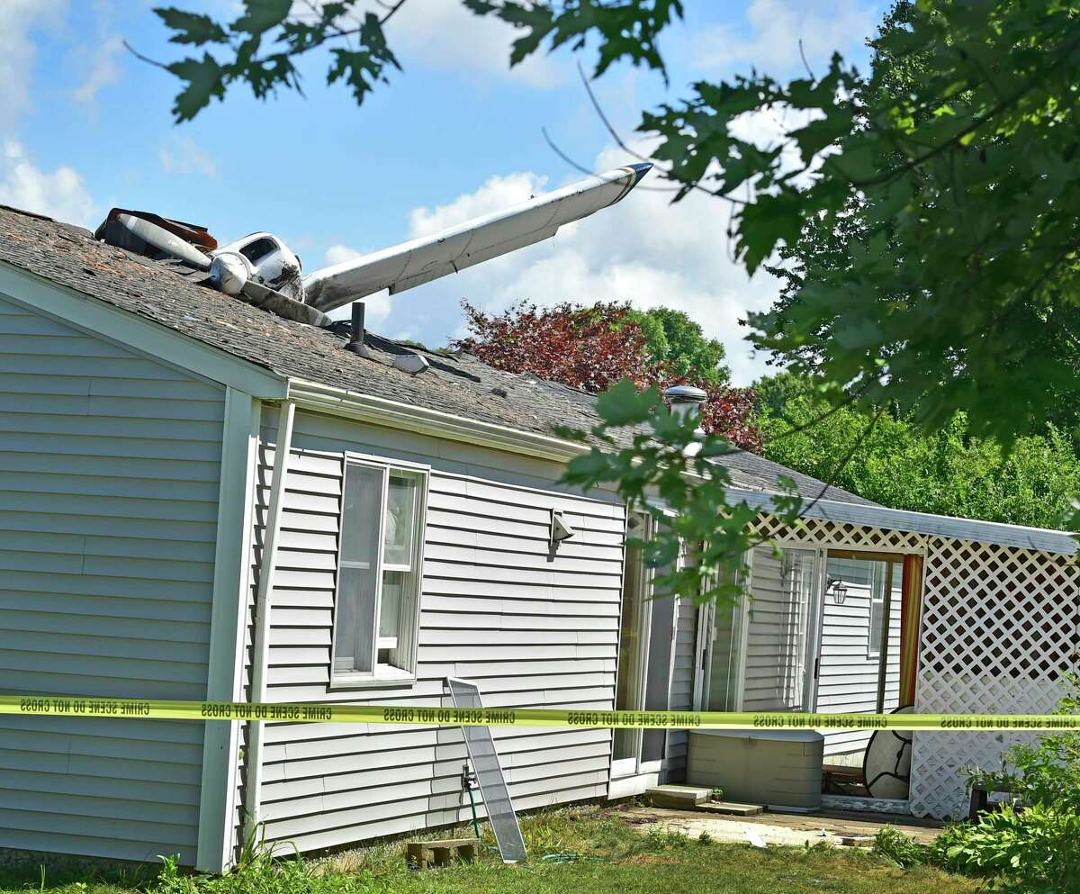 No one was injured after a small plane crashed into an occupied house Monday night at 243 Ring Avenue in Groton. Police said the airplane's two occupants were able to self-extricate themselves and were transported by ambulance to Lawrence + Memorial Hospital in New London.