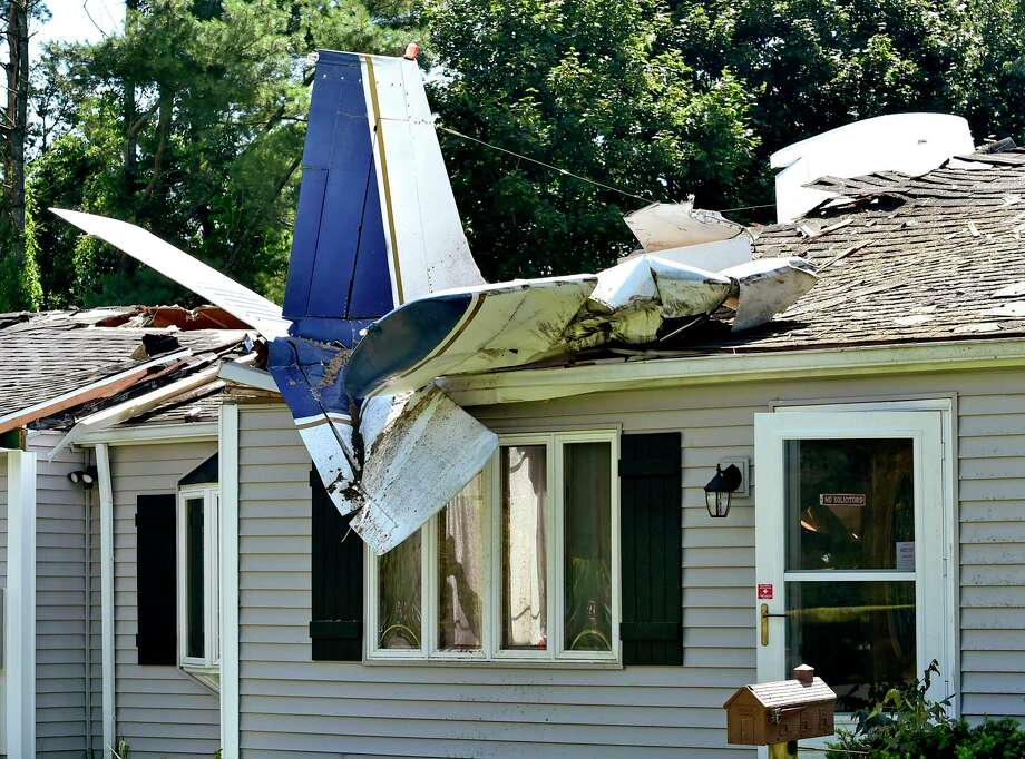 Groton, Connecticut - Tuesday, August 18, 2020:  No one was injured after a small plane crashed into an occupied house Monday night at 243 Ring Avenue in Groton. Police said the airplane's two occupants were able to self-extricate themselves and were transported by ambulance to Lawrence + Memorial Hospital in New London. Kenneth Johnson, 73, the owner of the house who was inside the house at the time of the crash, was not injured. Photo: Peter Hvizdak, Hearst Connecticut Media / New Haven Register