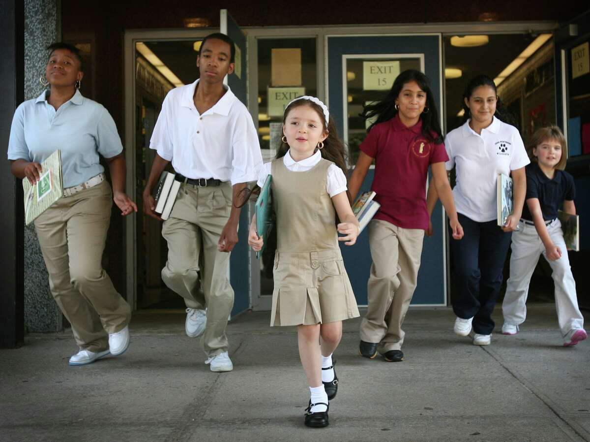 This 2009 file photo shows Bridgeport students as they model school uniforms when they were first introduced. School uniform rules may be relaxed in favor of concentrating on having students wear masks when school starts this fall.