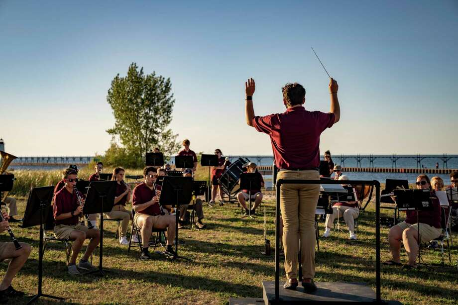 Conductor Ryan Biller leads the Manistee Community Band during a free concert at the Lions Pavilion at First Street Beach on Aug. 11. (Courtesy photo/Broadbent Photography) / Broadbent Photography
