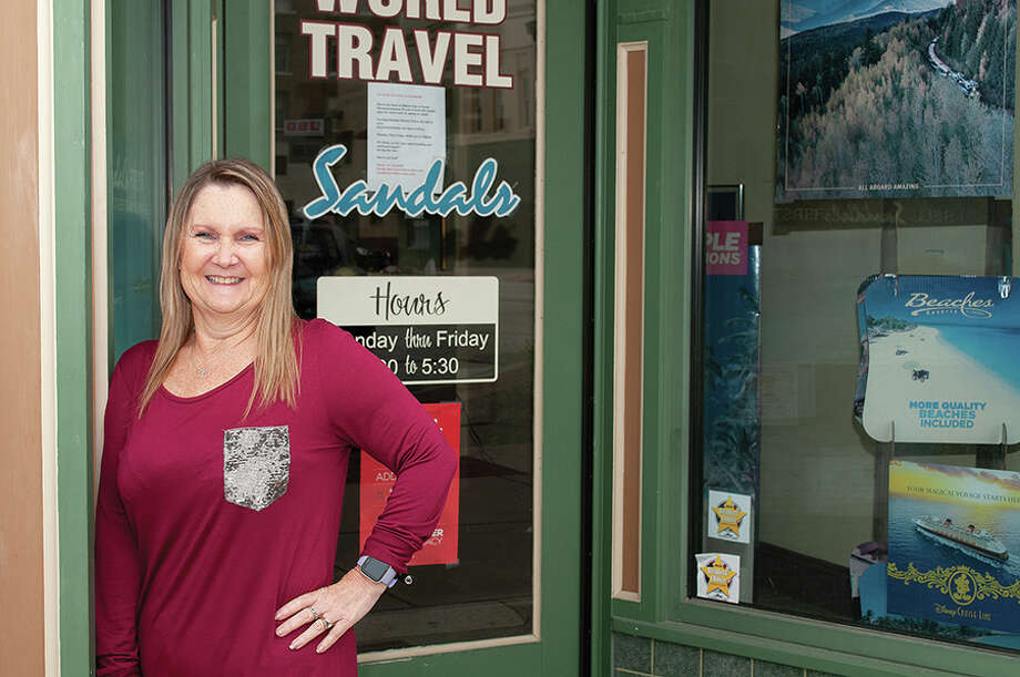 For Sherry Blair, owner of World Travel in Jacksonville, planning a trip or vacation for someone takes a lot of attention to details to risks these days. Photo: Darren Iozia | Journal-Courier