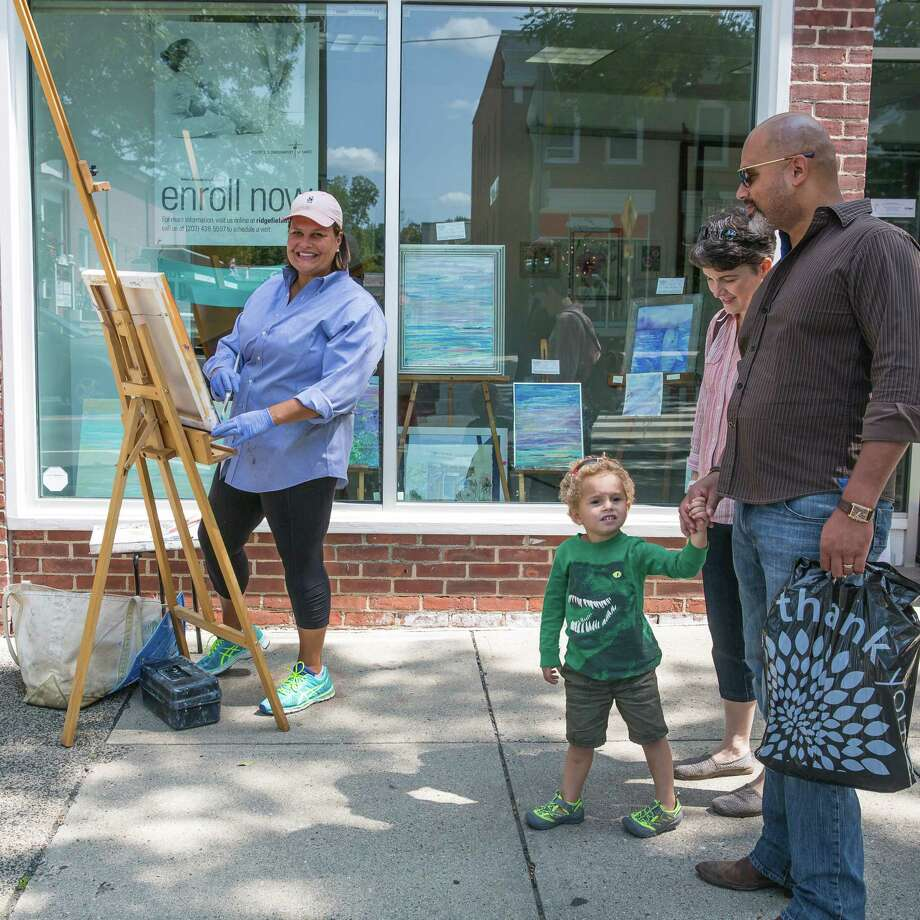 Ridgefield's annual Art Walk brings strollers out to watch artists at work out on the village street. Photo: Contributed Photo / Hearst Connecticut Media / Copyright 2015  Mary Harold