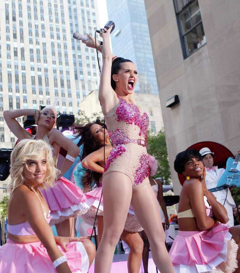 "Singer Katy Perry, center, performs on NBC's ""Today"" in New York's Rockefeller Center Friday, Aug. 27, 2010.  (AP Photo/Jason DeCrow) Photo: Jason DeCrow / FR103966 AP"