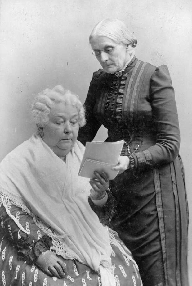 Elizabeth Cady Stanton, seated, and Susan B. Anthony, standing, in this portrait made between 1880 and 1902. Photo: Library Of Congress. / Library of Congress