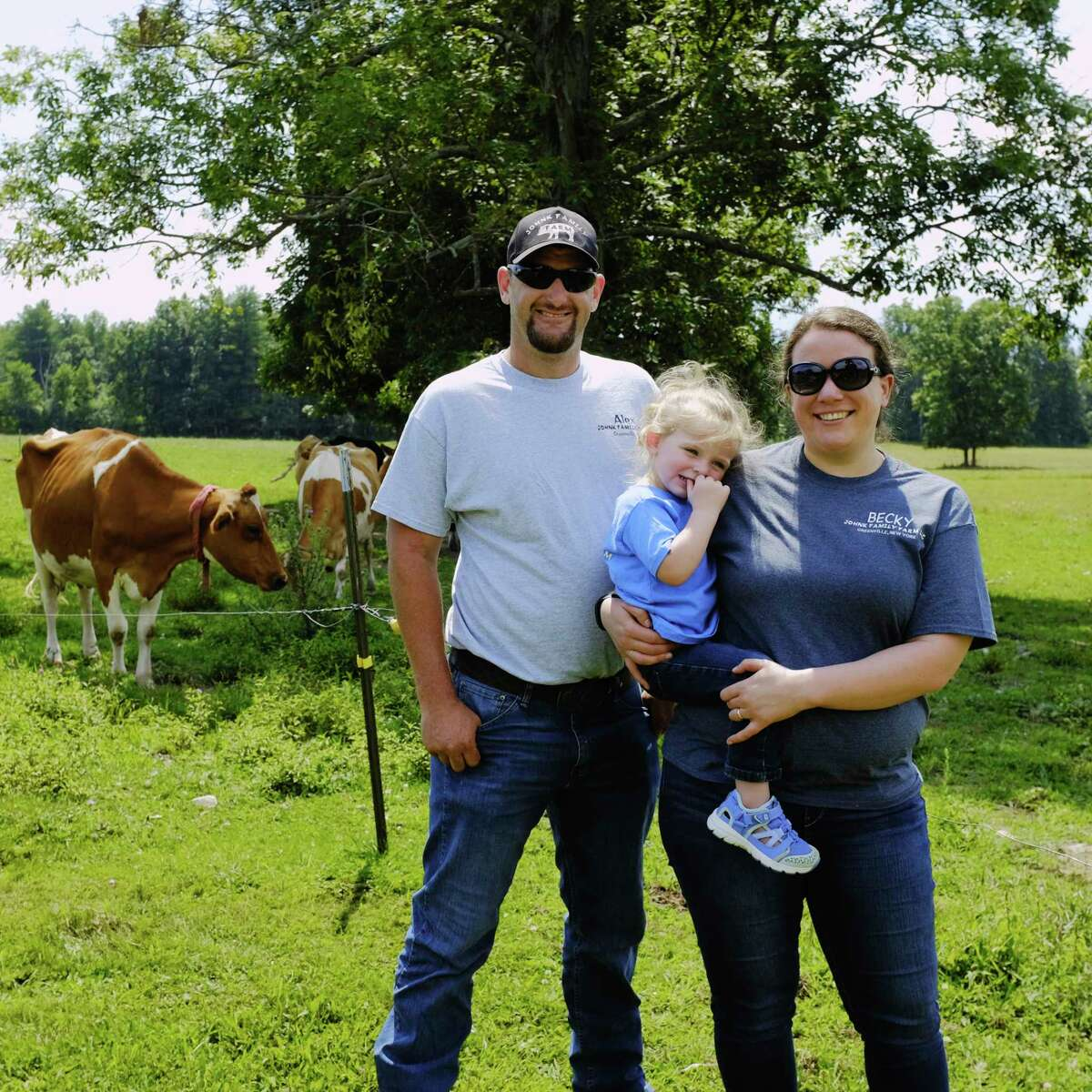 Alex Johnk, his wife Becky Johnk and their daughter, Rainy, pose for a photo at their farm, the Johnk Family Farm, on Monday, Aug. 10, 2020, in Greenville, N.Y. (Paul Buckowski/Times Union)