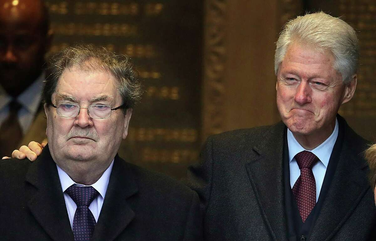 FILE - In this March 5, 2014 file photo of former US President Bill Clinton with John Hume at the Guildhall in Londonderry, Northern Ireland. The family of politician John Hume, who won Nobel Peace Prize for work to end violence in Northern Ireland, says he has died. He was 83. The Catholic leader of the moderate Social Democratic and Labour Party , Hume was regarded by many as the principal architect behind the peace agreement. (Paul Faith/PA via AP)