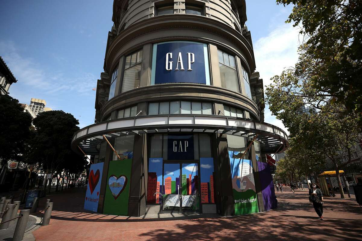 A sign is posted in front of the GAP flagship store on August 18, 2020 in San Francisco, California. Gap Inc. announced that they will permanently close its flagship store in San Francisco and all but one store in the city due to a drop in retail sales as the coronavirus COVID-19 pandemic continues.