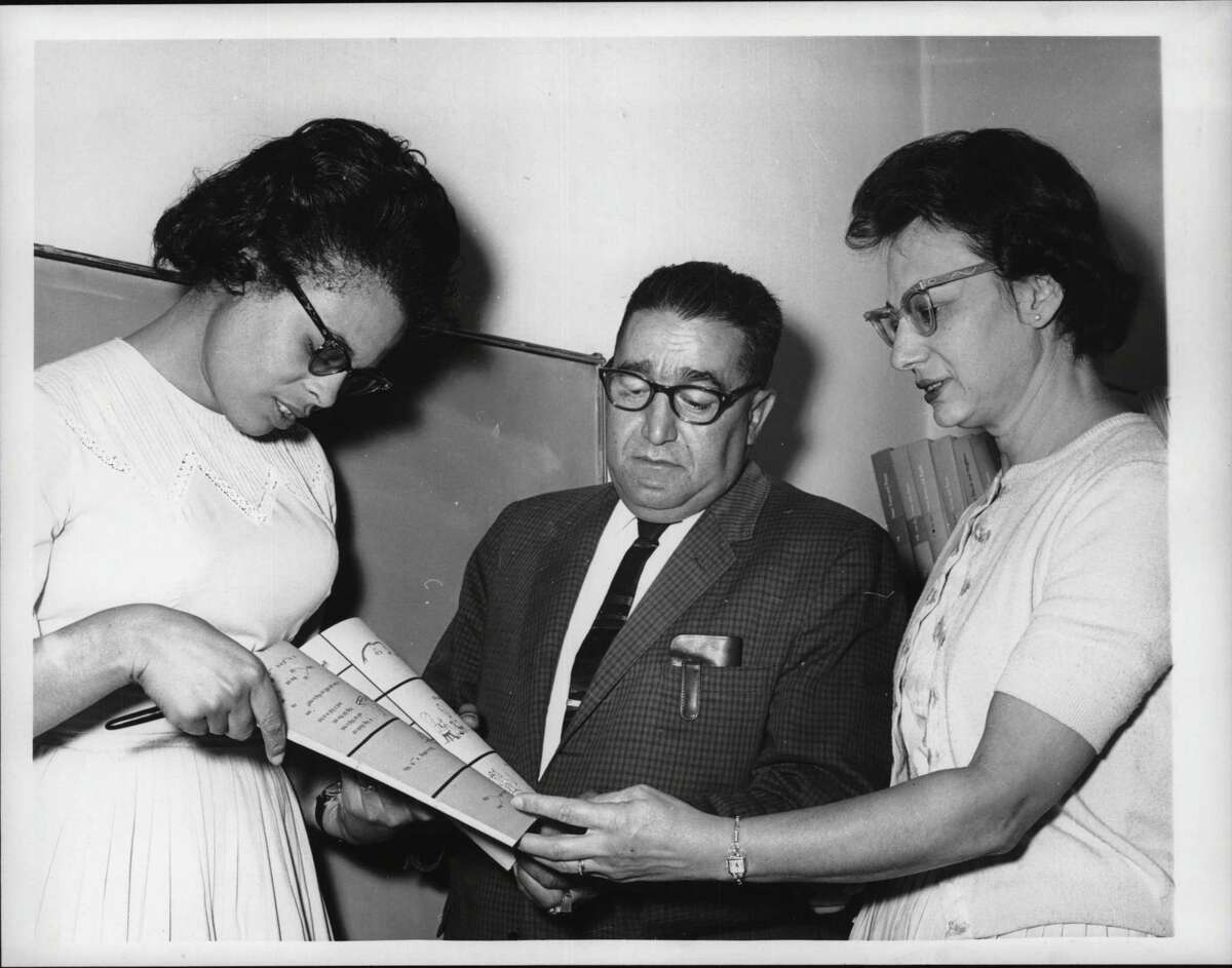 225 Ontario Street, Albany, New York - reviewing new McGraw-Hill programmed reading material - Mrs. Janet Matthews, teacher of Skills Class at School 5; Sam DiBlasi, Principal of schools 5 & 7; Mrs. Amelia Taranto, Teacher of Skills Class at School 7. August 19, 1964 (Bob Wilder/Times Union Archive)