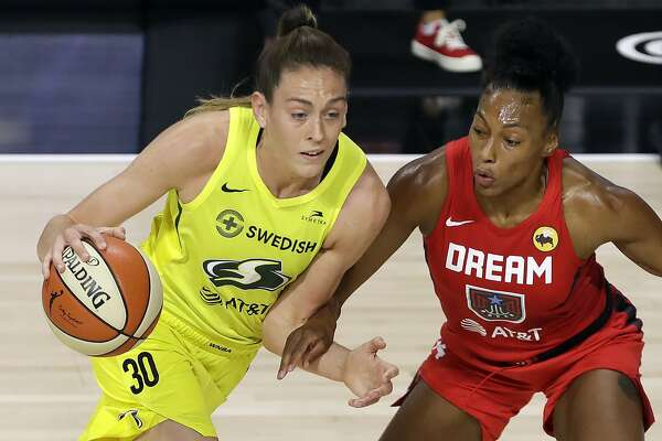 Seattle Storm forward Breanna Stewart (30) gets stopped by Atlanta Dream forward Betnijah Laney (44) during the first half of a WNBA basketball game Wednesday, Aug. 12, 2020, in Bradenton, Fla. (AP Photo/Chris O'Meara)
