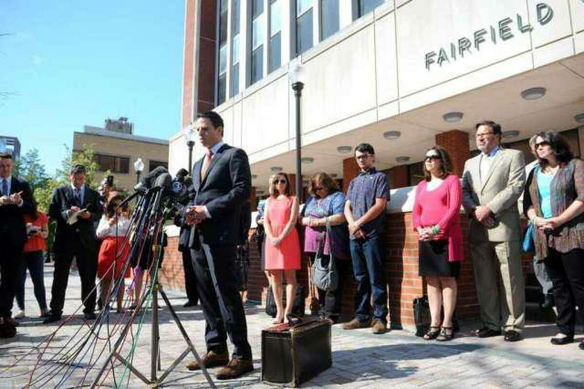 Attorney Joshua Koskoff stands with Sandy Hook family members as he speaks to a large group of media gathered in front of the Fairfield County Courthouse, in Bridgeport, Conn. June 20, 2016.