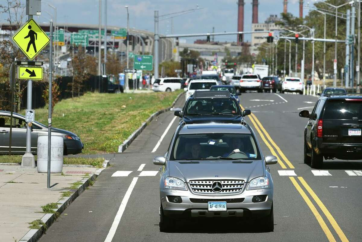 Cars travel along Long Wharf Drive in New Haven on August 18, 2020.