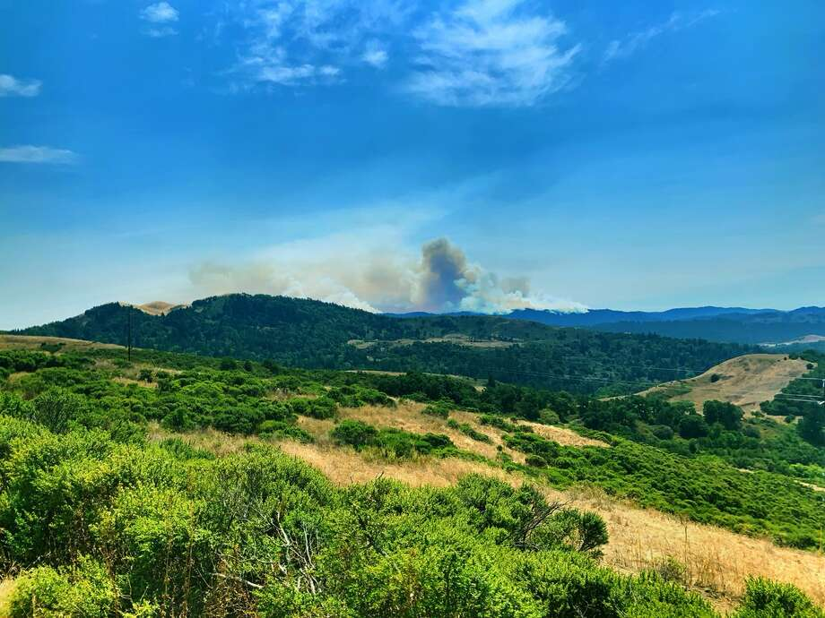 San Mateo County firefighters respond to a wildfire. Multiple fires were burning in San Mateo and Santa Cruz counties on Tuesday, Aug 18. 2020. Photo: Cal Fire CZU