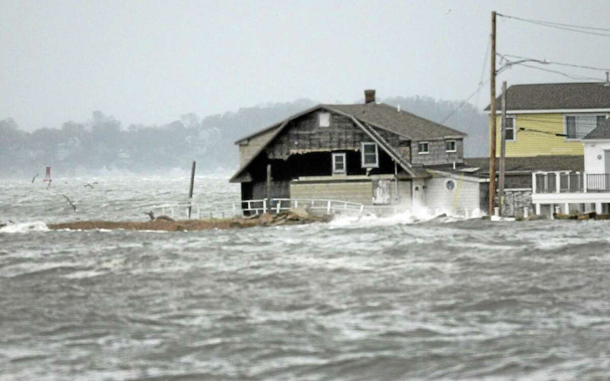 A house goes under water as Hurricane Sandy picks up speed with waves from Long Island Sound and hits the Cosey Beach area of East Haven Oct. 29, 2012. Natural disasters such as these are projected to increase in the coming years due to climate change, Middletown environmentalists say.