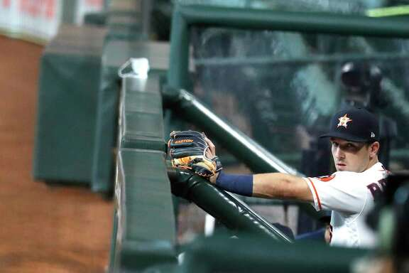 Houston Astros third baseman Alex Bregman (2) prepares to take the field to start the first inning of an MLB baseball game at Minute Maid Park, Tuesday, August 18, 2020, in Houston.