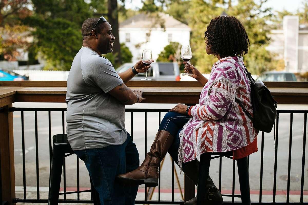 Edward Allen and Jennifer Allen enjoy their drinks on the outdoor patio of Cinnabar Winery's tasting room in Saratoga, Calif. Saturday, December 2, 2017.