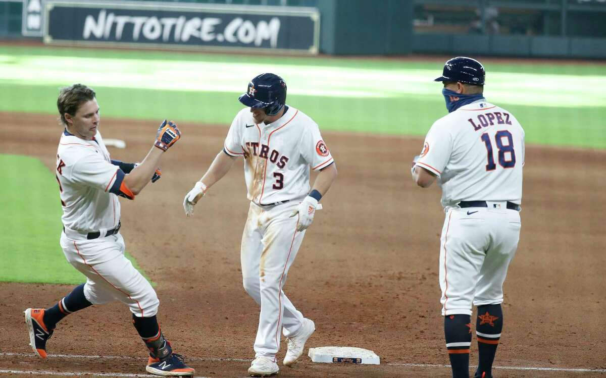Houston Astros Josh Reddick (22) runs at Myles Straw (3) after Straw hit an RBI single which allowed Abraham Toro to score the winning run during the eleventh inning of an MLB baseball game at Minute Maid Park, Tuesday, August 18, 2020, in Houston. Astros beat the Colorado Rockies 2-1.