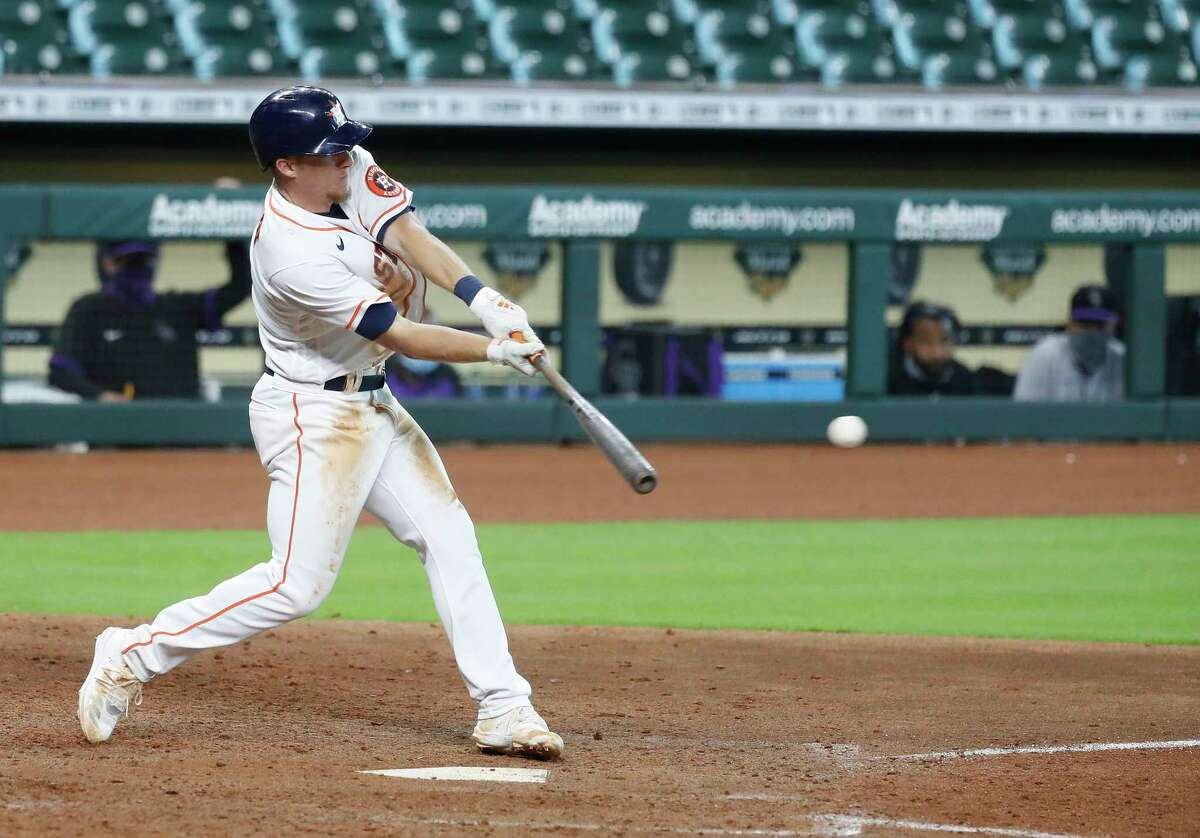 Houston Astros Myles Straw (3) hits an RBI single which allowed Abraham Toro to score the winning run during the eleventh inning of an MLB baseball game at Minute Maid Park, Tuesday, August 18, 2020, in Houston. Astros beat the Colorado Rockies 2-1.