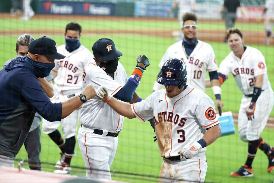 PHOTOS: A look at the Astros' celebration after Myles Straw's walk-off Houston Astros Myles Straw fist bumps pitching coach Brent Strom as the Astros celebrated after Straw hit an RBI single which allowed Abraham Toro to score the winning run during the eleventh inning of an MLB baseball game at Minute Maid Park, Tuesday, August 18, 2020, in Houston. Astros beat the Colorado Rockies 2-1. Photo: Karen Warren, Staff Photographer / © 2020 Houston Chronicle