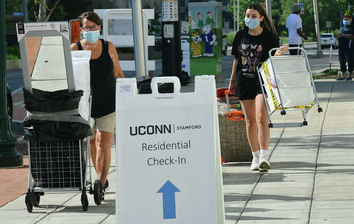 File photo of UConn students moving in to residence halls near the university's Stamford, Conn., campus on Friday, Aug. 14, 2020. Things got a bit more advanced after a study in 1942 (while all the scientists were probably smoking cigarettes) and there's a lot more history there but that's basically where the six-foot rule came from (6 feet is 1.8 meters). That's not to say 6 feet is a bad guideline. The Oxford study showed that risk of COVID-19 transmission is 10 times higher at 1 meter, compared to a 2-meter distance. But it ignores basic physics which says that