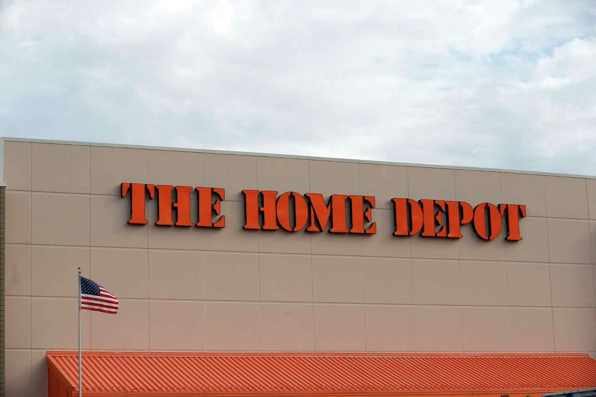 FILE - In this Aug. 27, 2019 file photo, the Home Depot logo is shown on a store in Bloomington, Minn. Home Depota€™s fiscal second-quarter sales surged to easily top Wall Streeta€™s expectations as consumers continued working on home projects and gardening amid the coronavirus outbreak. (AP Photo/Jim Mone, File)