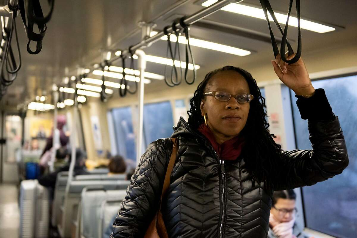 Lateefah Simon, BART's new board president and a single mom who is legally blind, riding BART during her morning commute on January 16, 2020 in Richmond, Calif.