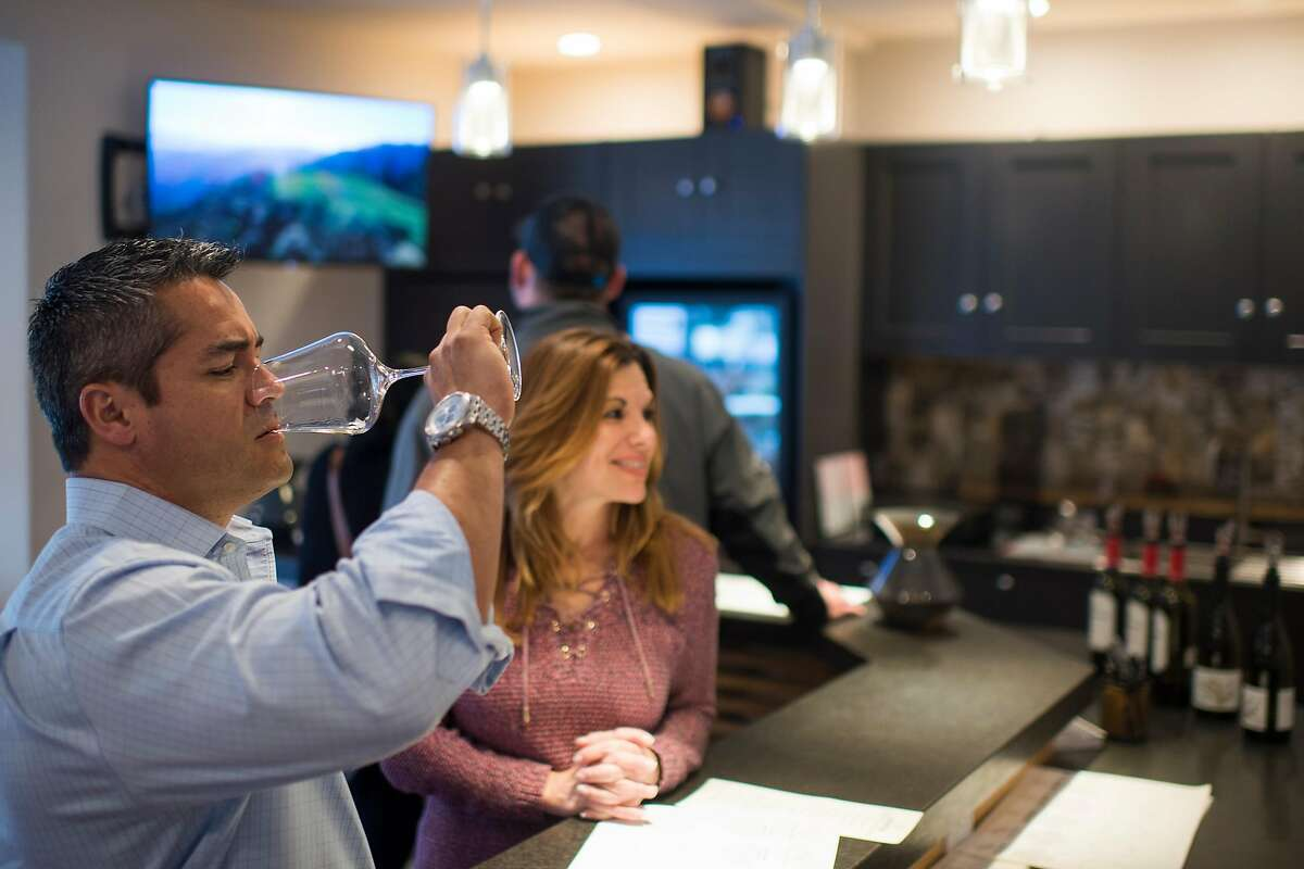 Customers taste wines at Lexington Wine/Mindego Ridge Tasting Room in Saratoga, Calif.