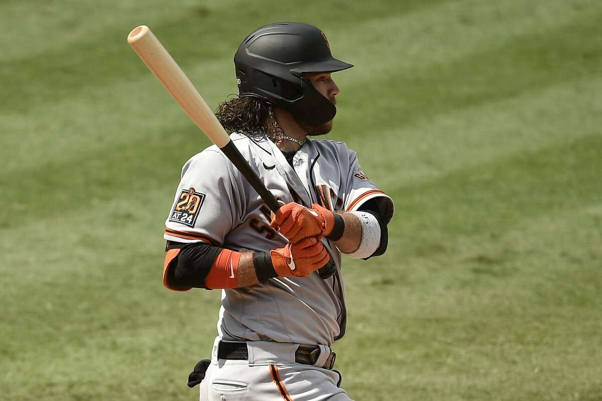 San Francisco Giants shortstop Brandon Crawford follows through on a swing for a two-run double during the fifth inning of a baseball game against the Los Angeles Angels in Anaheim, Calif., Tuesday, Aug. 18, 2020. (AP Photo/Kelvin Kuo)