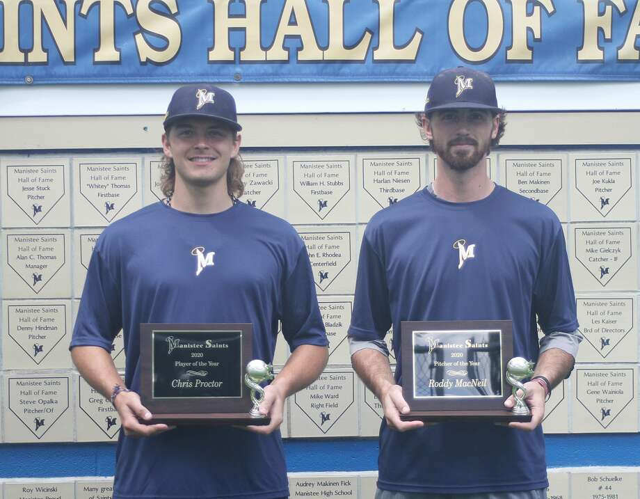 The Manistee Saints' Cole Proctor, left, and Roddy MacNeil, right, receive their postseason awards. Proctor was named the team's Player of the Year and MacNeil was named Pitcher of the Year. (Dylan Savela/News Advocate) Photo: Dylan Savela/News Advocate