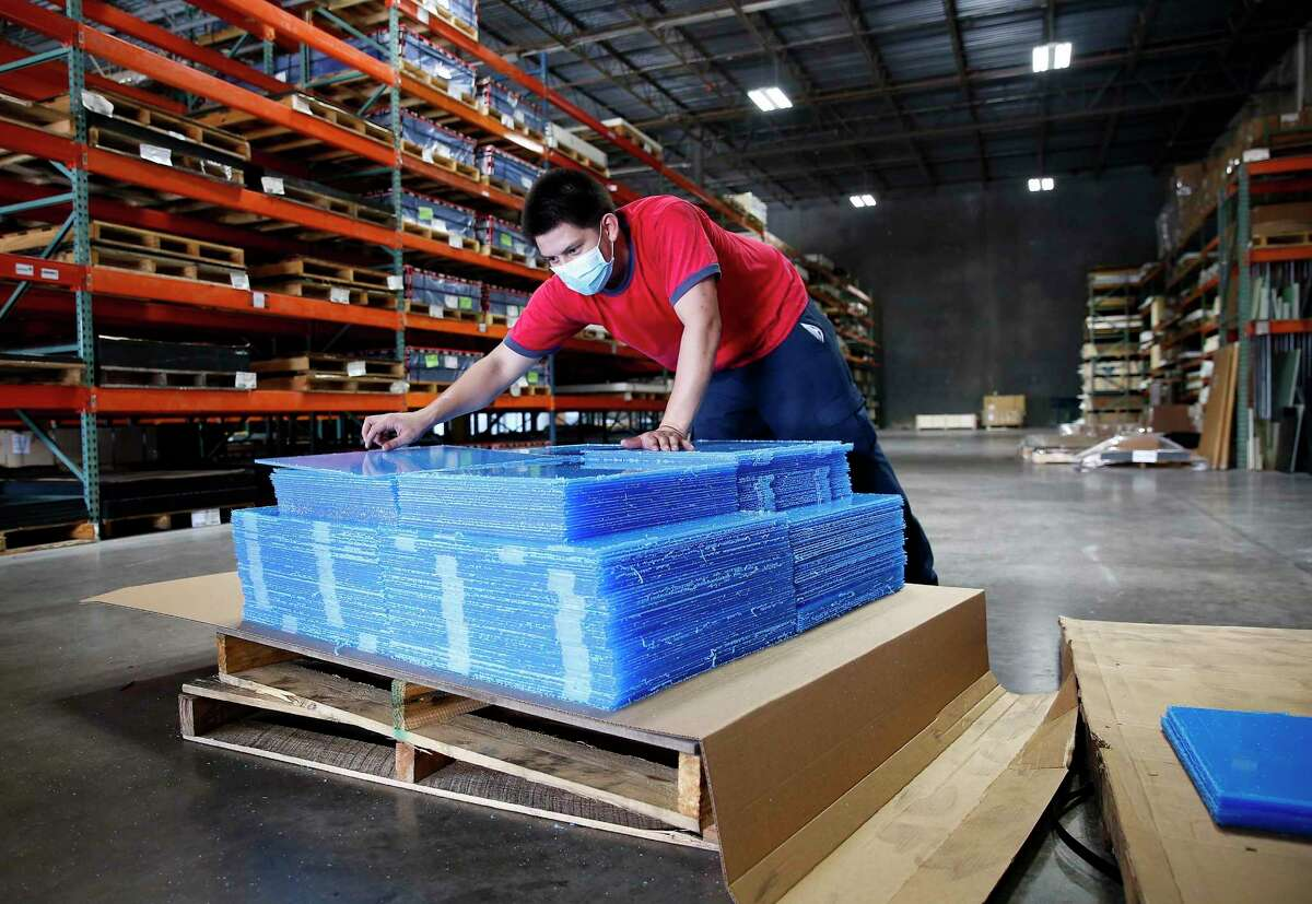 Andrew Valadez, a forklift operator for Professional Plastics, stacks parts for dividers for a local school in the Stafford, Texas warehouse on Thursday, Aug. 13, 2020.