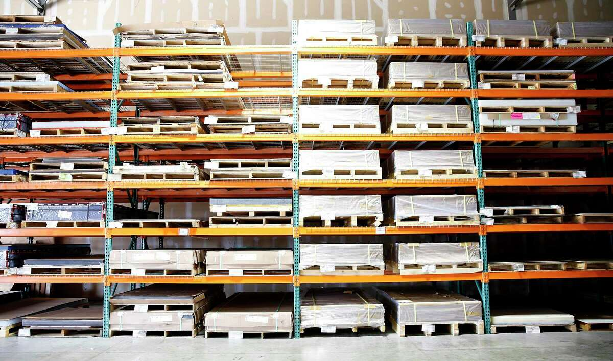 Pallets of acrylics in the inventory at Professional Plastics' Houston area location in Stafford on Thursday, Aug. 13, 2020. The company had $10,000 worth of raw acrylic on hand to meet demand early in the pandemic, but now it has more than $1 million's worth.