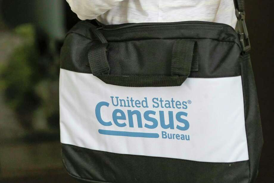 A briefcase of a census taker is seen as she knocks on the door of a residence Tuesday, Aug. 11. A half-million census takers head out en mass this week to knock on the doors of households that haven't yet responded to the 2020 census. Photo: John Raoux, STF / Associated Press / Copyright 2020 The Associated Press. All rights reserved