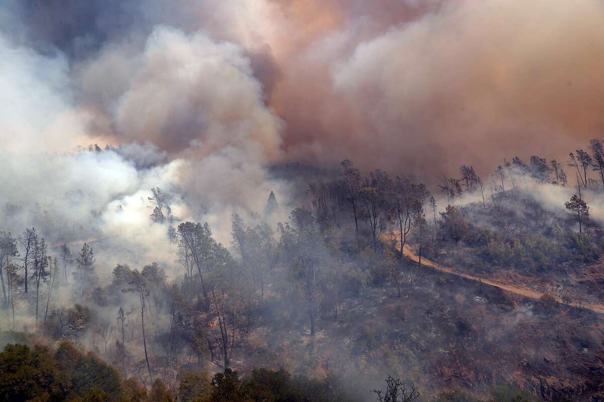 Smoke blows away from the Nichelini Winery which was threatened by the Hennessey Fire near St. Helena, Calif., on Tuesday, August 18, 2020. The 130-year-old winery was largely unaffected with one building uphill from the main winery suffering damage from the fire.