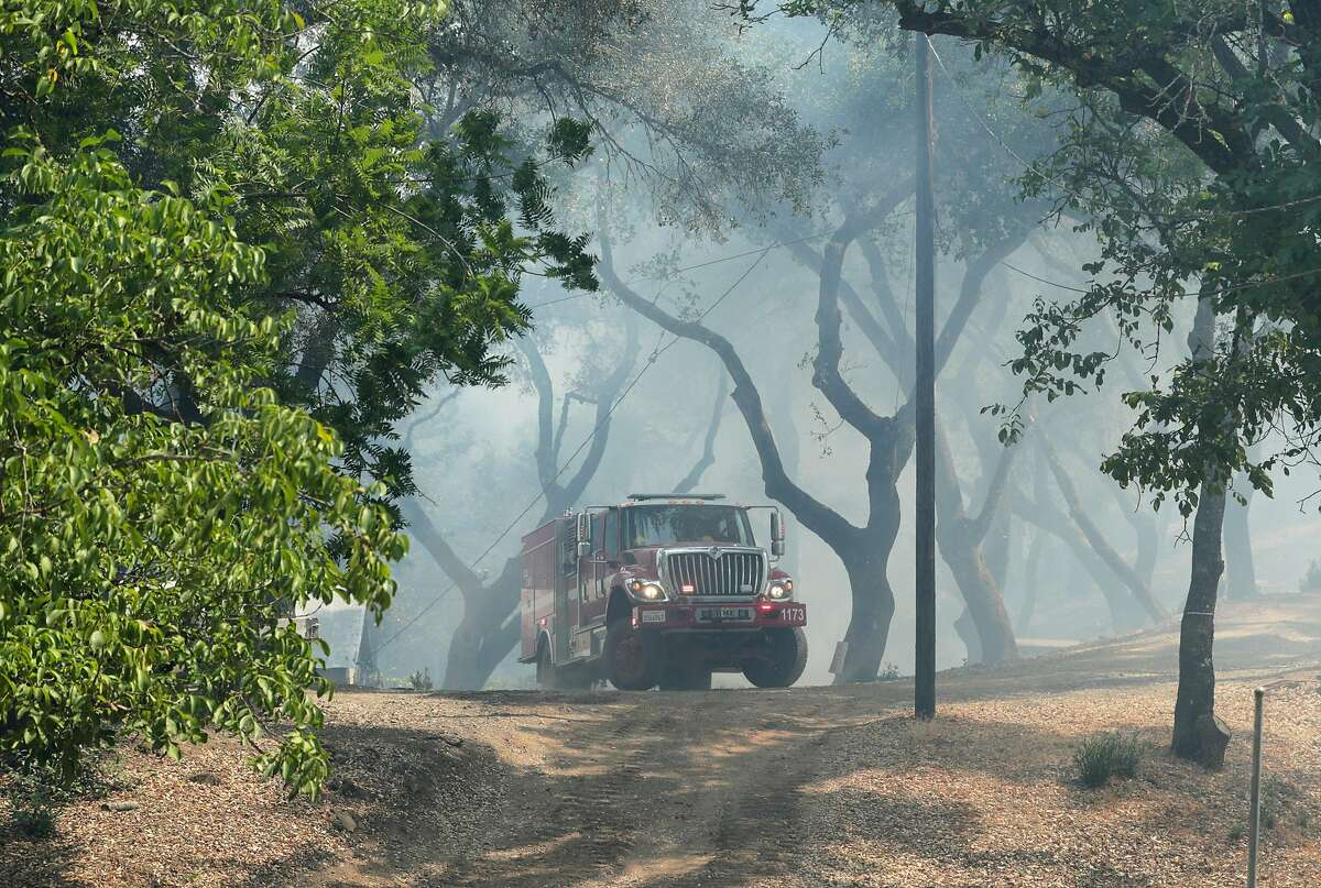 CalFire crews conduct structure protection at the Nichelini Winery which was threatened by the Hennessey Fire near St. Helena, Calif., on Tuesday, August 18, 2020.