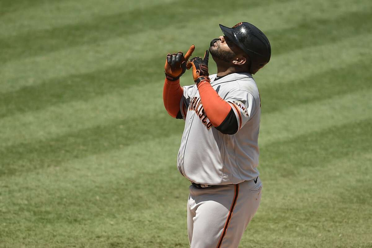 San Francisco Giants designated hitter Pablo Sandoval looks up at home plate off a two-run home run during the second inning of a baseball game against the Los Angeles Angels in Anaheim, Calif., Tuesday, Aug. 18, 2020. (AP Photo/Kelvin Kuo)