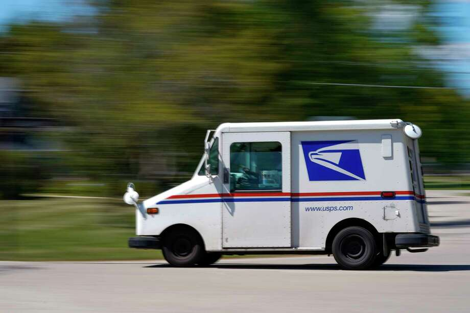 A mail truck moves down a street Tuesday, Aug. 18, 2020, in Fox Point, Wis. Facing public pressure and state lawsuits, the Postmaster general announced Tuesday he is halting some operational changes to mail delivery that critics warned were causing widespread delays and could disrupt voting in the November election. (AP Photo/Morry Gash) / Copyright 2020 The Associated Press. All rights reserved.
