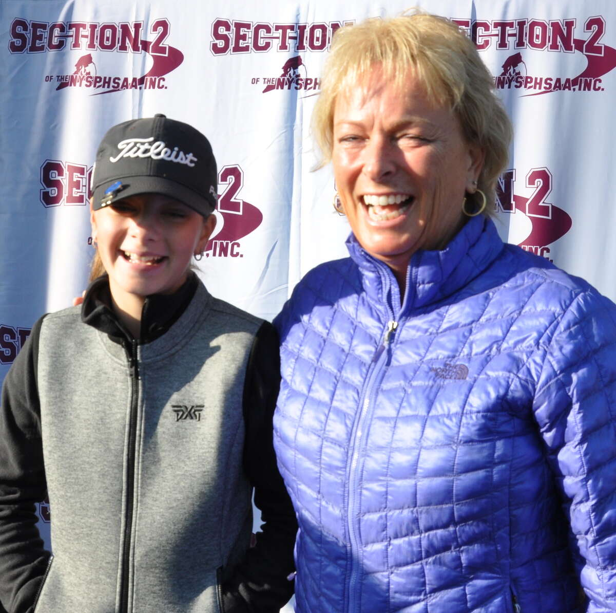 LPGA star Dottie Pepper of Saratoga Springs and Kennedy Swedick of Albany Academy for Girls share a hug and a laugh at the first Section 2 Girls Golf sectional and state qualifier on Oct. 11, 2019, at Fairways of Halfmoon. Pepper spoke to the players and signed autographs before the event. (Joyce Bassett / Times Union)
