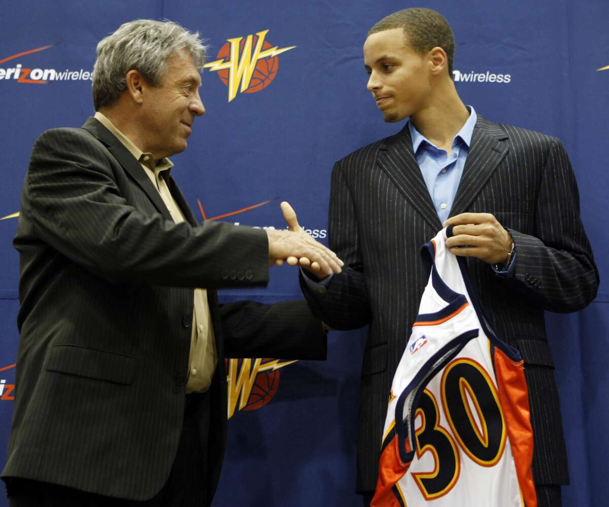 Golden State Warriors top draft pick Stephen Curry shake hands with Warriors general manager Larry Riley during a news conference on June 26, 2009.