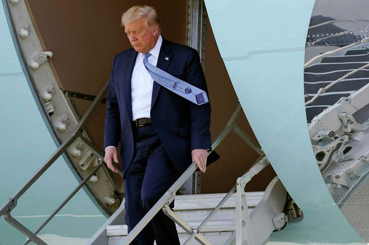 CORRECTS FROM FLOOD DAMAGE TO DERECHO DAMAGE - President Donald Trump exits Air Force One as he arrives at the Eastern Iowa Airport for a briefing on derecho damage, Tuesday, Aug. 18, 2020, in Cedar Rapids, Iowa. (AP Photo/Evan Vucci)