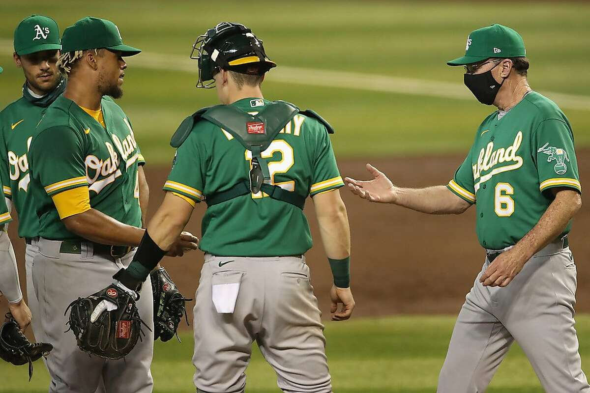 PHOENIX, ARIZONA - AUGUST 18: Manager Bob Melvin #6 of the Oakland Athletics removes starting pitcher Frankie Montas #47 of the Oakland Athletics during the second inning of the MLB game at Chase Field on August 18, 2020 in Phoenix, Arizona. (Photo by Christian Petersen/Getty Images)