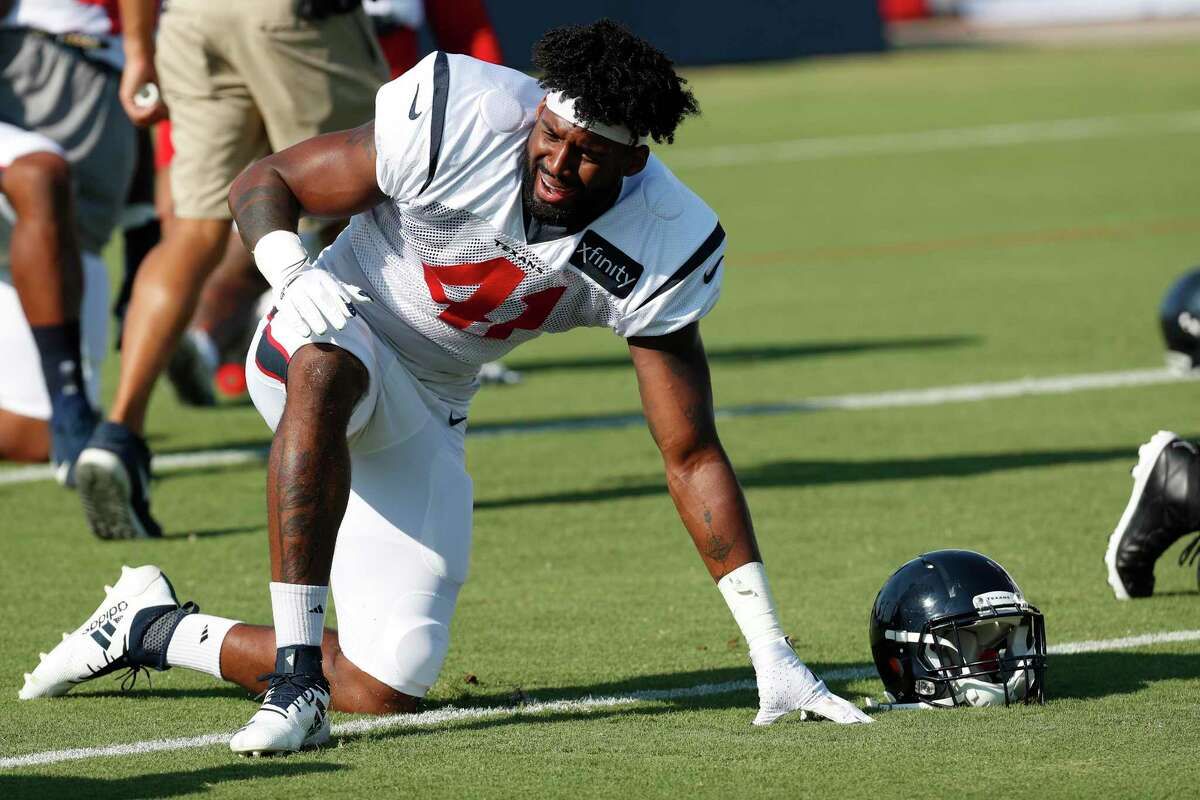 Houston Texans linebacker Zach Cunningham warms up during an NFL training camp football practice Tuesday, Aug. 18, 2020, in Houston.
